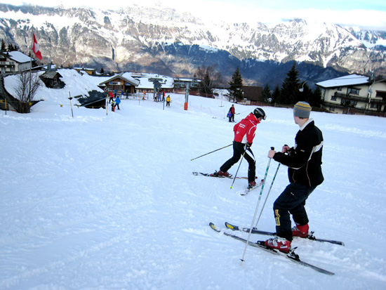 Ski instructor teaching client