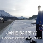 Jamie Barrow - snowboarder being towed by a plane