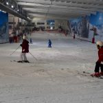 Family skiing snow centre