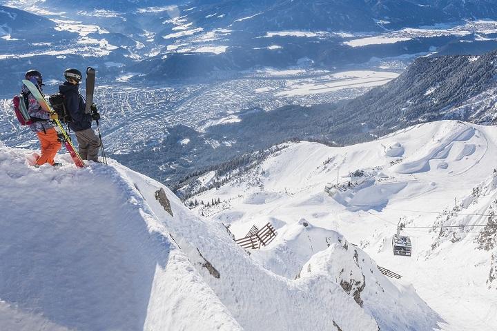 Skiers overlooking Innsbruck